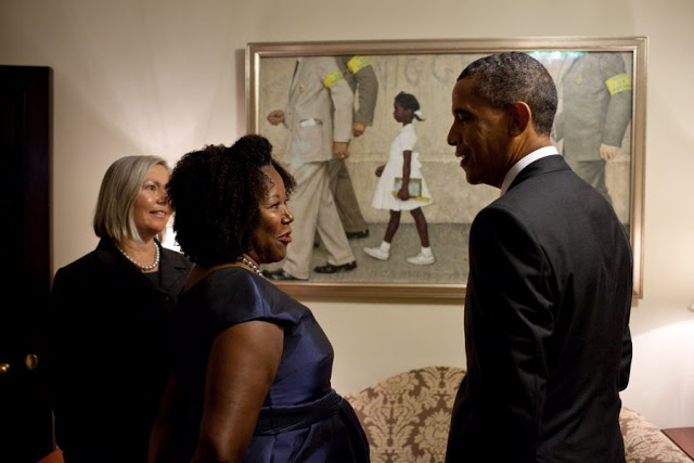ng-of-school-desegregation-in-new-orleans-the-problem-we-all-live-with-was-displayed-in-the-white-house-this-year-here-obama-meets-with-its-subject-ruby