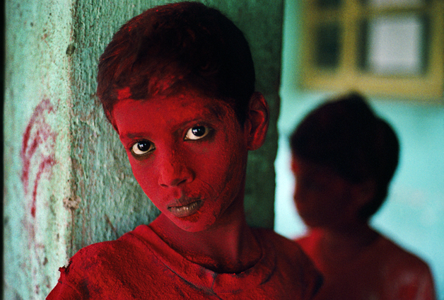 Boy covered in red powder participates in the Festival of Ganesh Chaturthi, marking the birthday of the elephant headed deity Lord Ganesh, son of Lord Shiva and Parvati, and one of Hinduism's most popular deities. Praying to Ganesh during the festival is