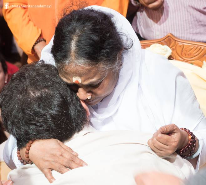 Amma has offered this embrace to more than 34 million people over the last four decades. (Photo taken at MalpensaFiere in Busto Arsizio, Italy on November 9, 2014)