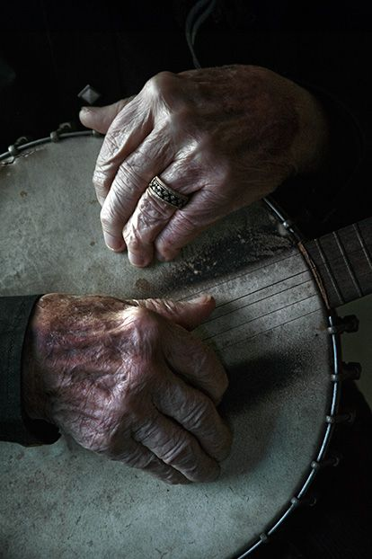 Ralph Stanley's fingers on his banjo by Jim Herrington